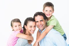 Cheerful young family looking at camera together Royalty Free Stock Photography