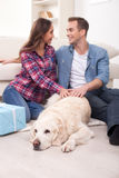 Cheerful young family is relaxing at home Stock Photos