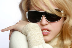 Cheerful young fashionable girl in dark glasses royalty free stock photography
