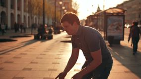 Cheerful young fat male dancing outdoor in city evening light. stock video
