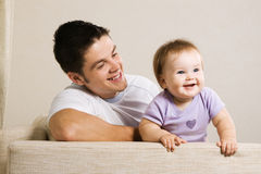 Cheerful young father with lovely little daughter Royalty Free Stock Photos