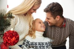 Cheerful young father, mother and daughter looking at each other Royalty Free Stock Photo