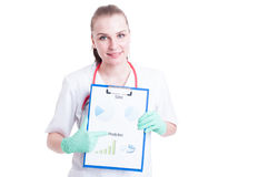 Cheerful young female doctor showing clipboard with diagram Stock Photo