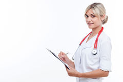 Cheerful young female doctor is working with Stock Photo