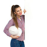 Cheerful Young Female Engineer Posing With A Banner Royalty Free Stock Image