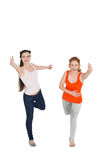 Cheerful young female friends with hand gestures Royalty Free Stock Photo