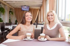 Cheerful young female friends are resting together Stock Photos