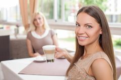 Cheerful young female friends are spending time Royalty Free Stock Images