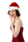 Cheerful young female santa laughing Stock Images