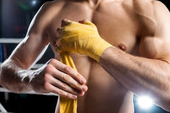 Cheerful young fighter is preparing for fighting Stock Images