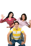 Cheerful young friends. Cheerful three young friends standing in a funny position and showing happiness,copy space for text ,white background,check also Teenage Stock Photos