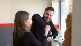 Close-up of young couple resting in a small coffee shop and drinking cappuccino. stock footage