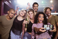 Cheerful young friends talking selfie at nightclub Royalty Free Stock Photo