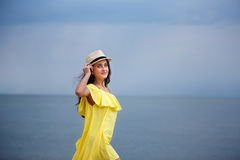 Cheerful young girl on the beach stock photos