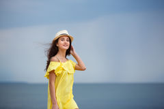Cheerful young girl on the beach stock images