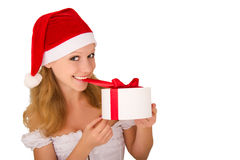 Cheerful young girl with Christmas present. On white background stock photos