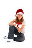 Cheerful young girl with Christmas present. Cheerful young beautiful girl with Christmas present royalty free stock photo