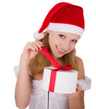 Cheerful young girl with Christmas present. Cheerful young girl with a Christmas gift in the hands of stock photos