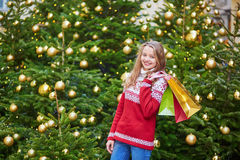 Cheerful young girl with colorful shopping bags Stock Photography
