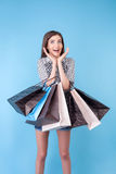 Cheerful young girl is crazy about shopping Royalty Free Stock Images