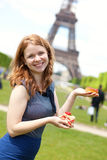 Cheerful young girl with delicious French cakes Royalty Free Stock Photography