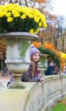 Cheerful young girl enjoying a fall day Stock Images