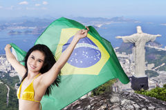 Cheerful young girl with flag of Brazil Stock Photo