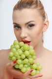 Cheerful young girl with fresh green fruit Stock Photos