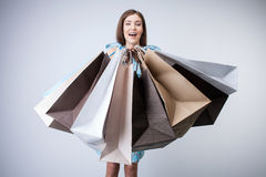 Cheerful young girl is going shopping with joy Royalty Free Stock Image