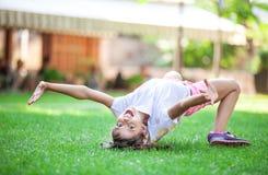 Cheerful young girl going to do bridge exercise. Stock Photos