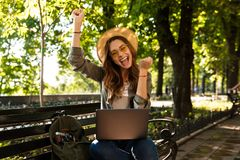 Cheerful young girl in hat and sunglasses royalty free stock photography