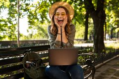 Cheerful young girl in hat and sunglasses stock photography