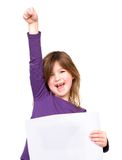 Cheerful young girl holding blank sign with one arm raised Stock Photos