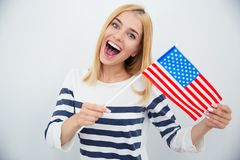 Cheerful young girl holding USA flag Stock Photo
