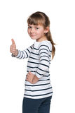 Cheerful young girl holds her thumb up Stock Photography
