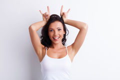 Cheerful Young Girl Is Making Faces With Fun Stock Images