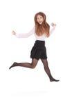 Cheerful young girl jumping Stock Photos