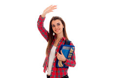 A cheerful young girl in Plaid Shirt raised hand up Royalty Free Stock Photos