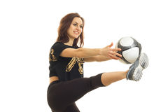 Cheerful young girl playing soccer with ball Royalty Free Stock Images
