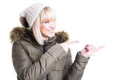 Cheerful young girl pointing finger at something Stock Image