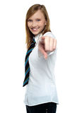 Cheerful young girl pointing towards the camera Royalty Free Stock Image