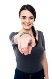 Cheerful young girl pointing you out Stock Images