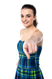 Cheerful young girl pointing you out Royalty Free Stock Images
