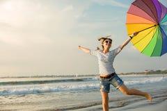 Cheerful young girl with rainbow umbrella having Royalty Free Stock Photo