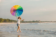 Cheerful young girl with rainbow umbrella having Royalty Free Stock Image