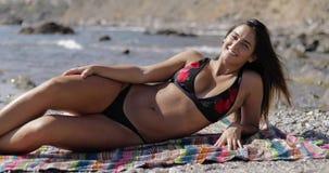 Attractive young model posing in bikini stock footage