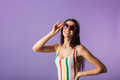 Cheerful young girl wearing swimsuit standing royalty free stock photos