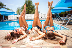 Cheerful young girls are getting a suntan on royalty free stock images