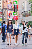 Cheerful young girls in a shopping area, Shanghai, China Royalty Free Stock Photography