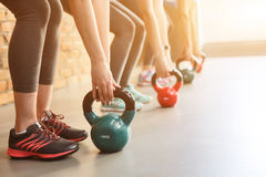 Cheerful young girls are training their body Royalty Free Stock Photo